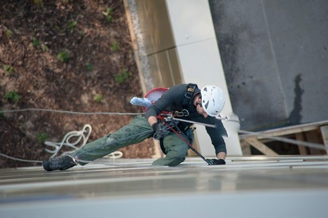 Don't look down. An Aquamark window cleaning abseil specialist at work in London
